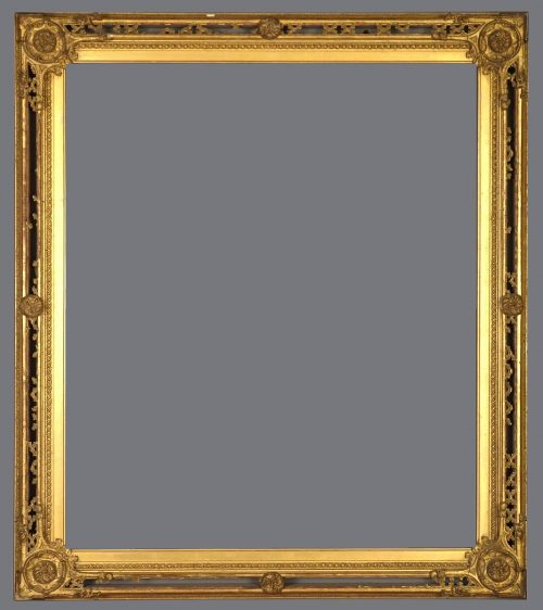 Late 19th C. English Gothic Revival gold leaf frame with corner and center roundels.