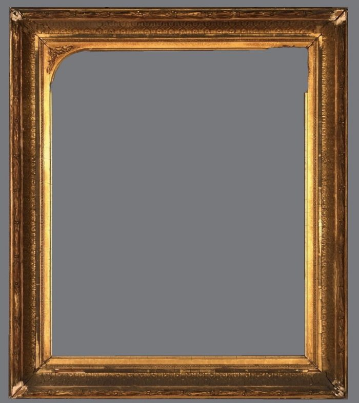 Late 19th C. American gold leaf and gold metal leaf applied ornament frame with an arched interior top.
