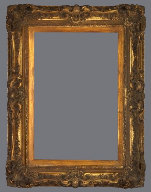 Late 19th C. German gold leaf and applied ornament frame in the Louis XV style.