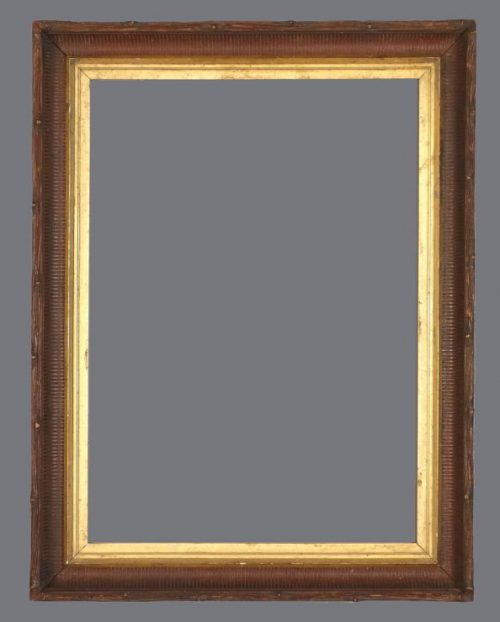 Late 19th C. American walnut fluted cove frame with a gold leaf liner.