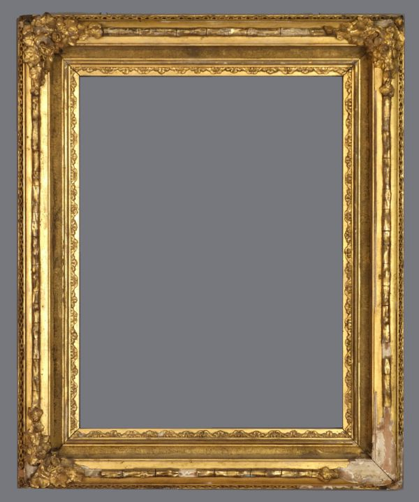 Mid 19th C. American gold leaf cove frame with applied ornament.