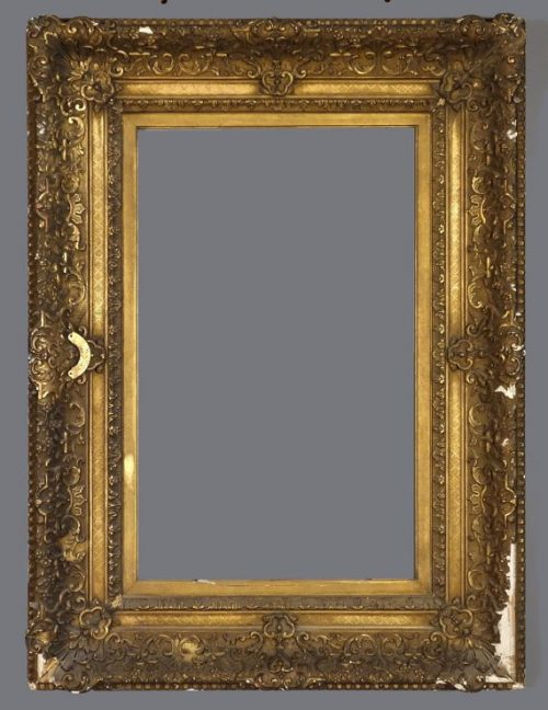 Late 19th C. American(?) gold leaf and applied ornament frame in the Louis XIV style.