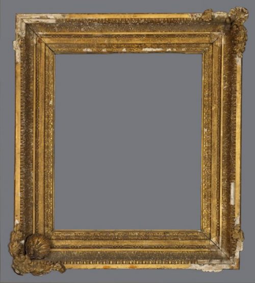 Late 18th or early 19th C. gold leaf  cove frame with applied ornament.
