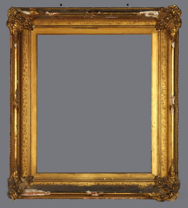 Mid 19th C. American gold leaf spotted cove frame with applied ornament.