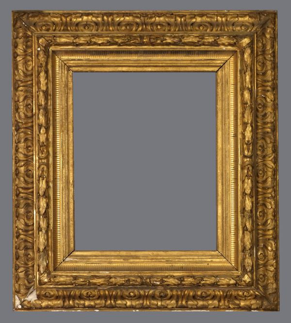 19th C. Italian reverse profile gold leaf and applied ornament frame.