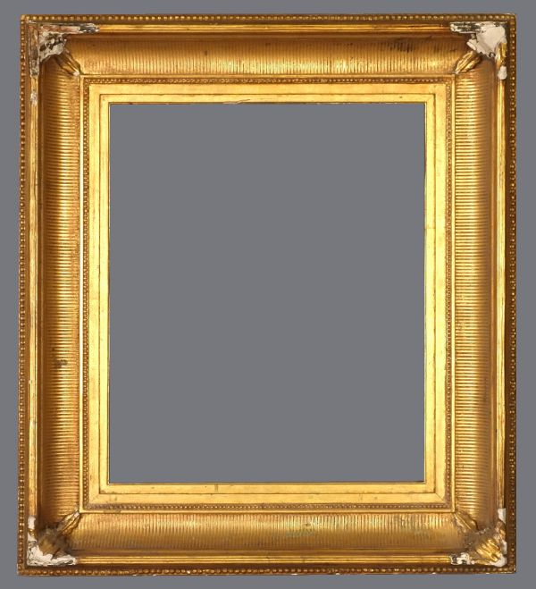 Late 19th C. American gold metal leaf fluted cove frame with applied ornament and reeded top edge.