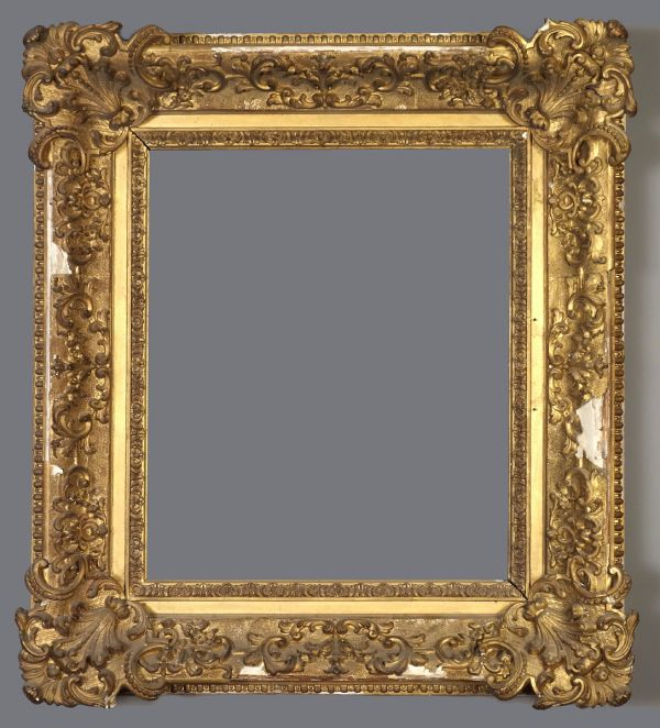 Late 19th C. American gold leaf, applied  ornament frame vaguely in the Louis XIV style.
