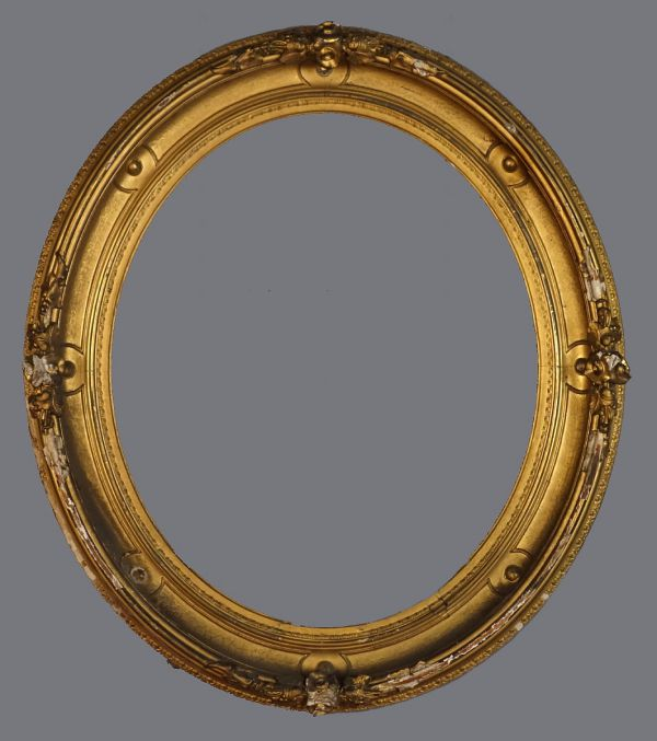 Mid 19th C American gold leaf  oval cove frame with applied ornament.
