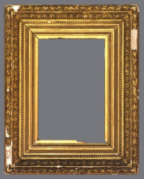 Late 19th C.  French gold leaf frame with applied ornament.
