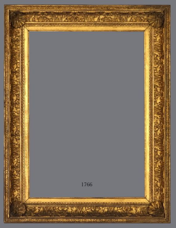 Early 19th C. English or American gold leaf cove frame with applied ornament.