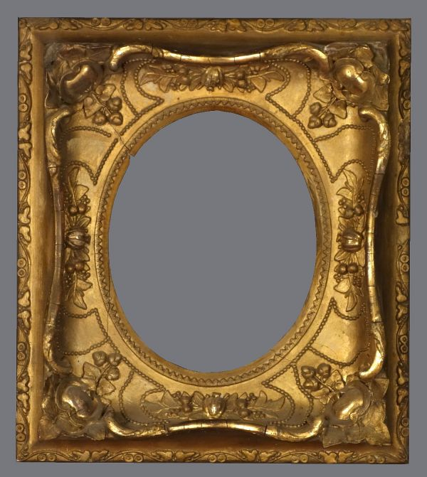 Late 19th C. gold leaf spandrel frame in the Louis XV style with applied ornament.