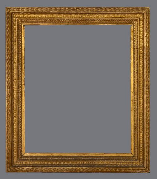 Early 19th C. English gold leaf cove frame with applied ornament.