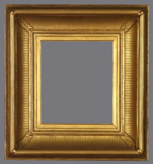 Late 19th C. American gold leaf fluted cove frame with applied ornament.