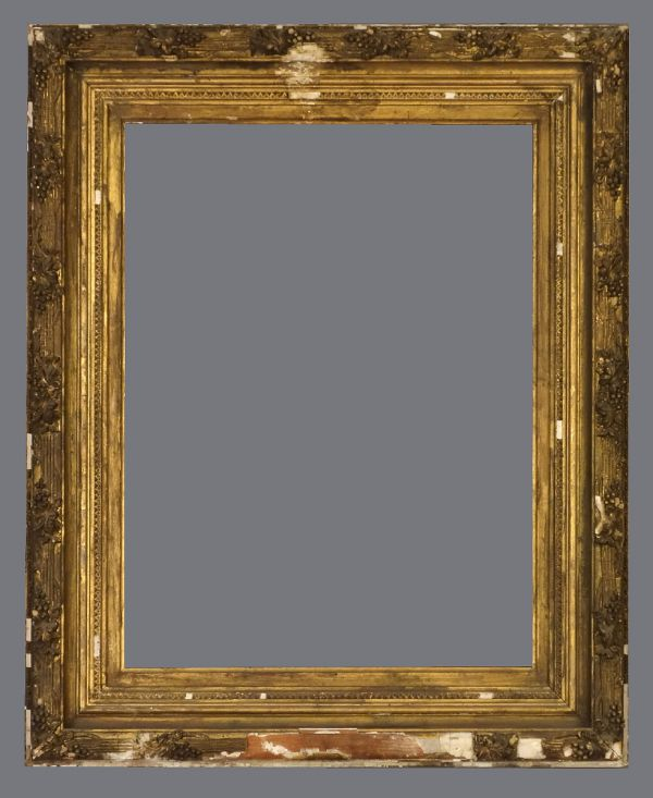 Mid 19th C. American, gold leaf and applied ornament frame.