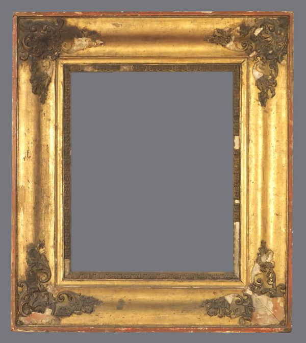 19th C. European gold leaf frame with a flattened ogee profile and applied ornament.
