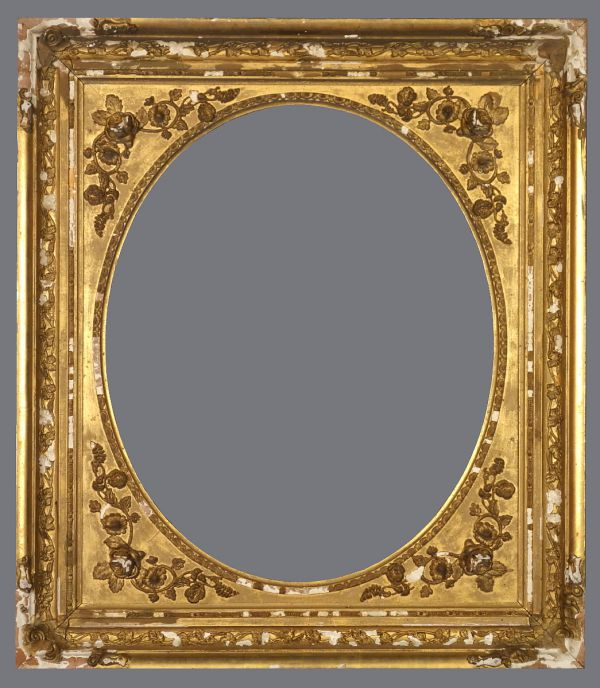 Late 19th C. American gold leaf cove frame with spandrel and applied ornament