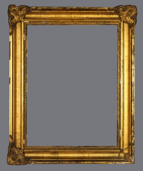 Early to mid 19th C.  silver leaf cove frame with gold varnish and applied ornament.