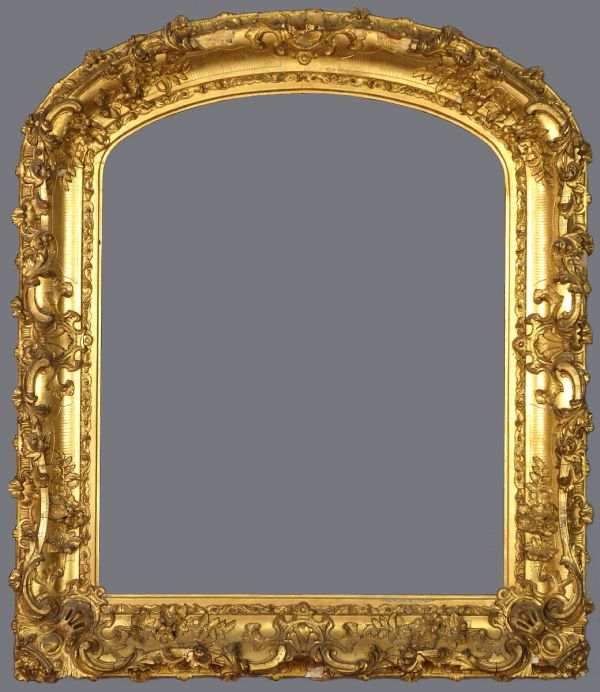 Late 19th C. gold leaf and applied ornament frame with an arched top.