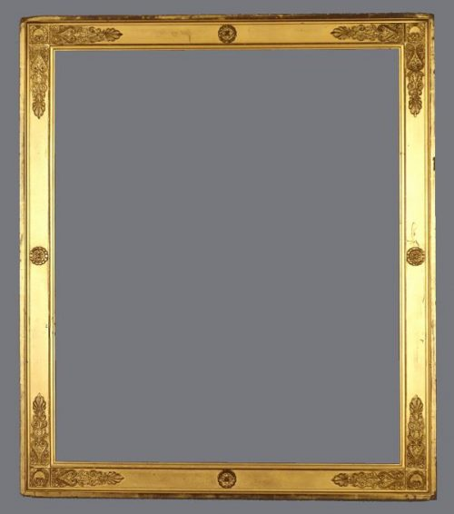 Late 19th to early 20th C. French, gold leaf and applied ornament Empire style frame.